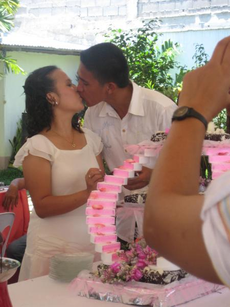 """a kiss after the cake """"ritual"""" taken during our wedding reception"""